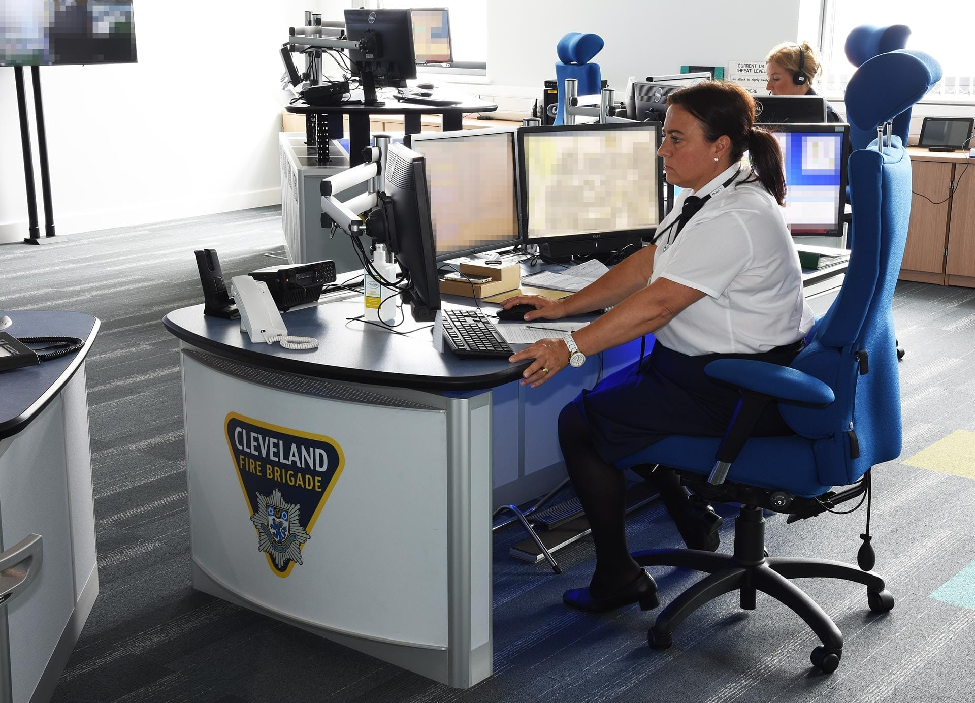 height-adjustable-consoles-for-cleveland-fire-brigade-thinking-space-systems-close up of desk